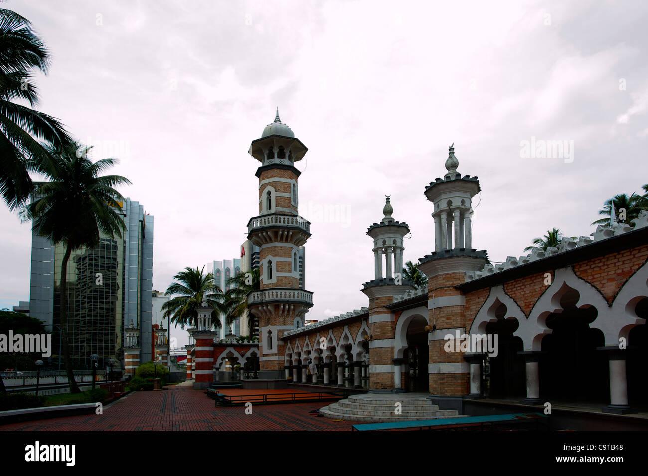 Masjid Jamek mosque under clouded sky, Kuala Lumpur, Malaysia, Asia - Stock Image