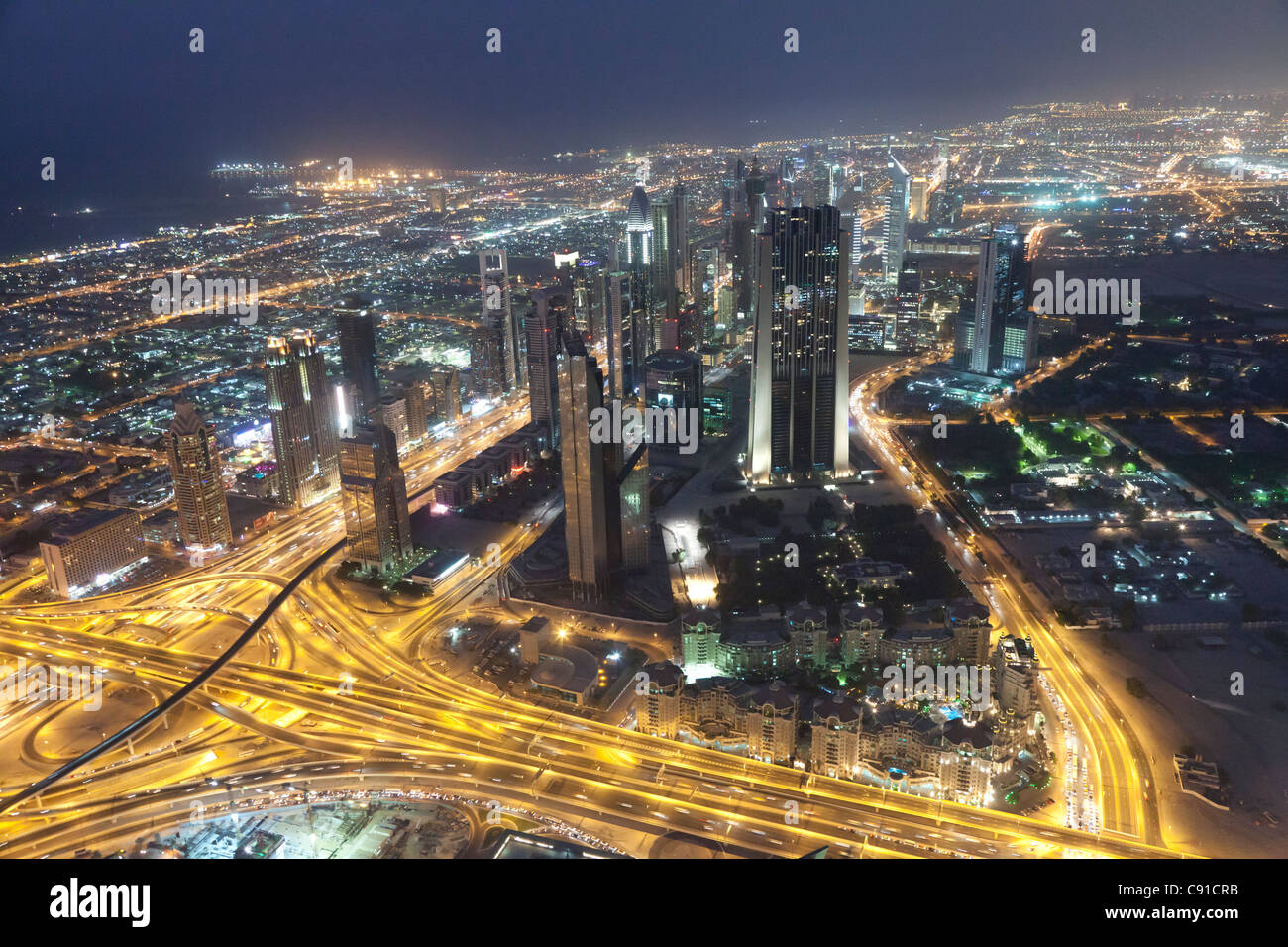 Aerial view of a highway junction in Dubai at nighttime - Stock Image