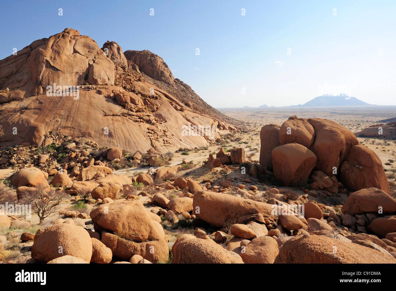 Red Granite Boulder : Red granite rock and balancing in savannah