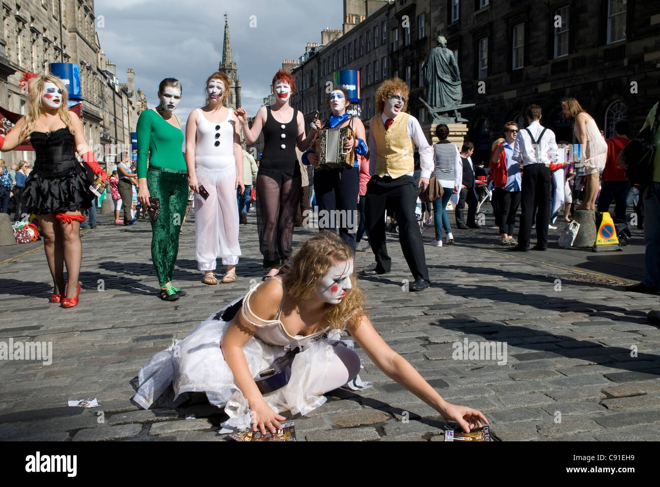 Artists promote their acts along the Royal Mile during the annual Edinburgh Festival of the arts. - Stock Image