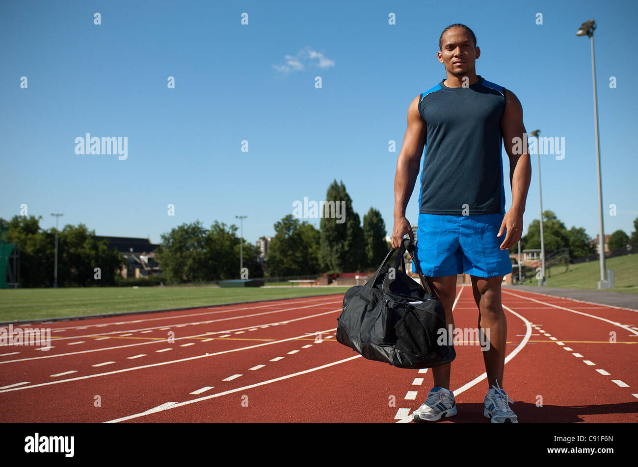 Athlete standing on track - Stock Image
