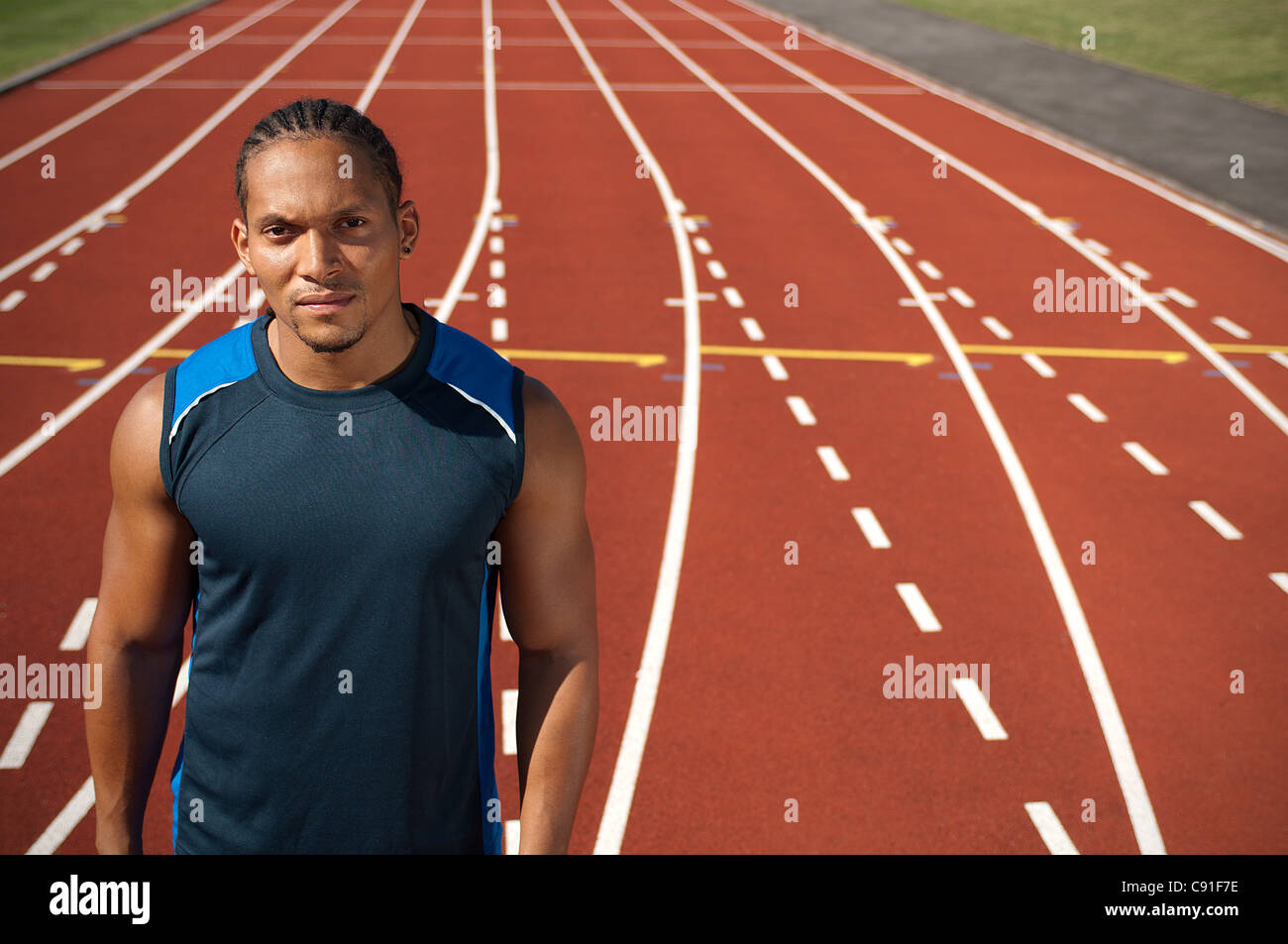 Athlete standing on track Stock Photo