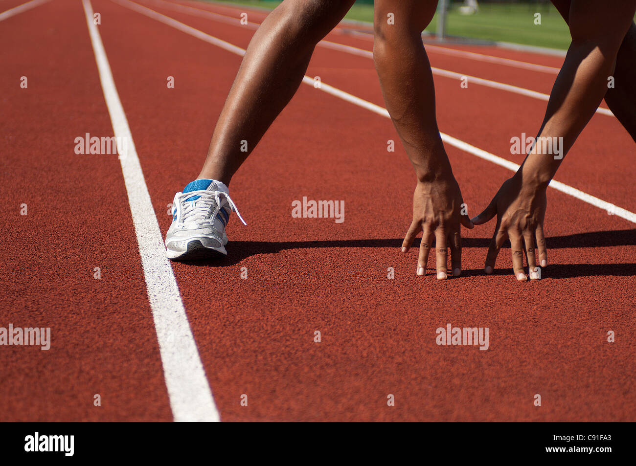 Close up of athlete in start position - Stock Image