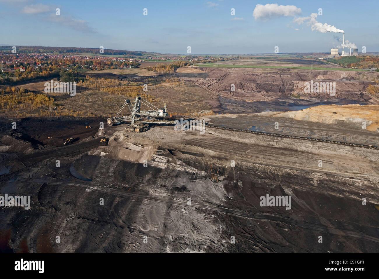 Aerial view of a bucket-wheel excavator with conveyor belt in for open-pit lignite mining brown coal Schoeningen - Stock Image