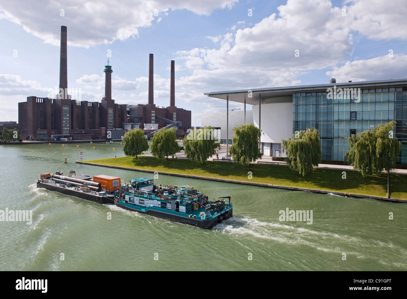 Ship on Mittelland Canal, VW Autostadt and Volkswagen Factory, Wolfsburg, Lower Saxony, Germany - Stock Image