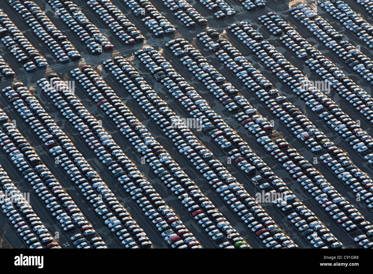 aerial of many parked vehicles at Volkswagen automobile plant, Wolfsburg, Lower Saxony Germany - Stock Image