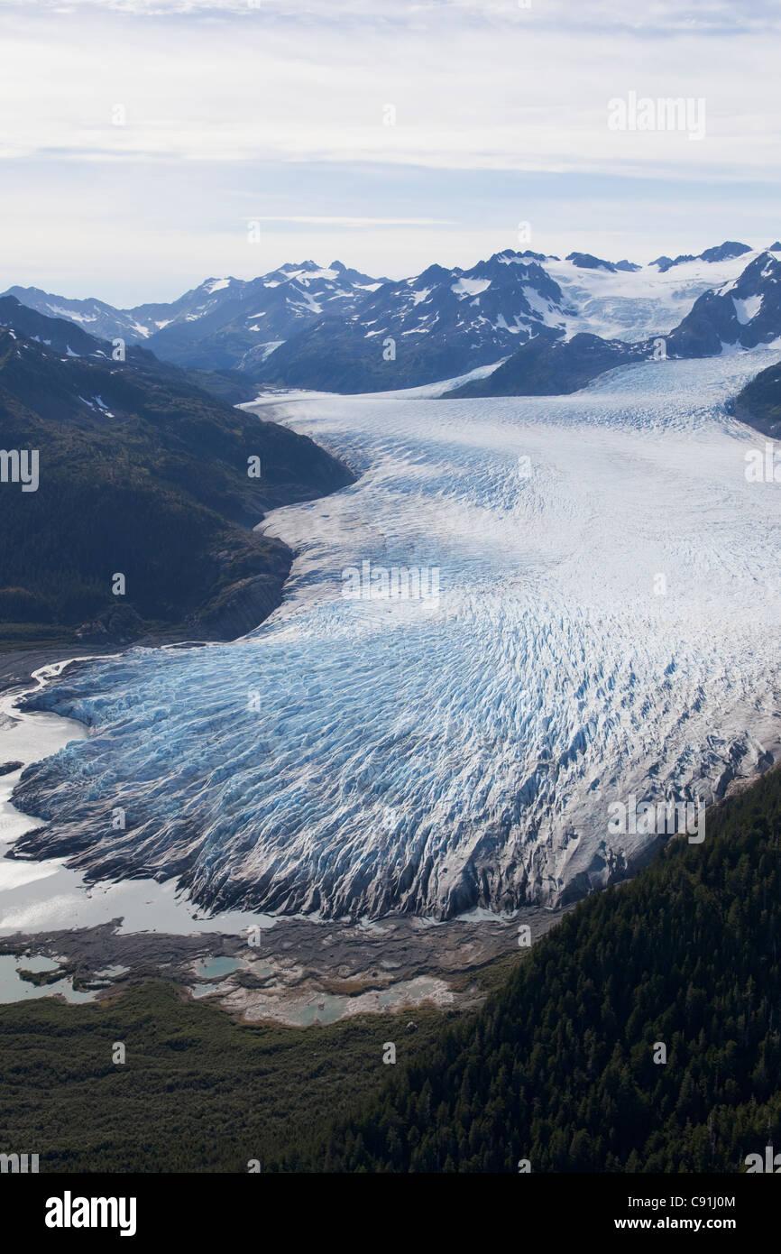Aerial over Bainbridge glacier and Chugach Mountains, Prince William Sound, Southcentral Alaska, Summer - Stock Image