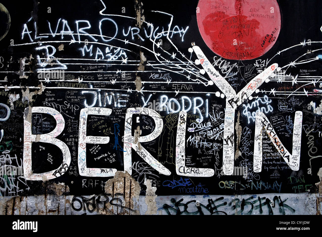East Side Gallery consists of paintings by artists from all over the world painted on the east side of the Berlin - Stock Image