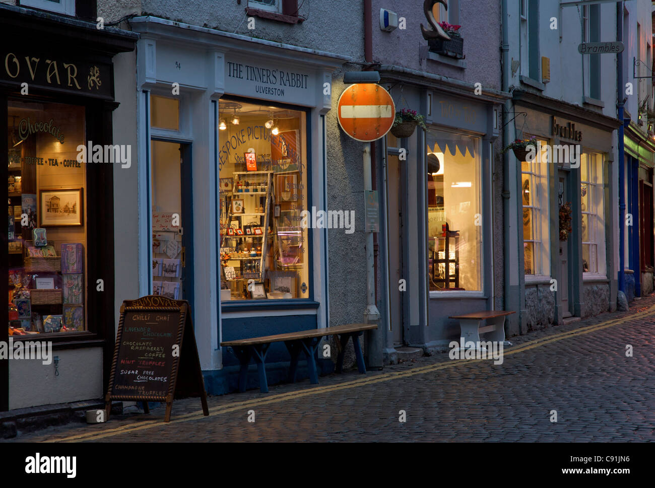 Small independent shops in Market Street, Ulverston, Cumbria, England UK - Stock Image