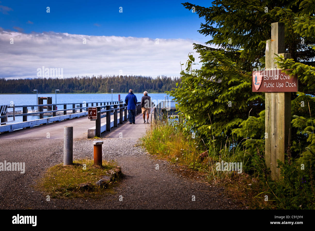 Visitors walking down to the public use dock in Bartlett Cove, Gustavus, Glacier Bay National Park & Preserve, - Stock Image