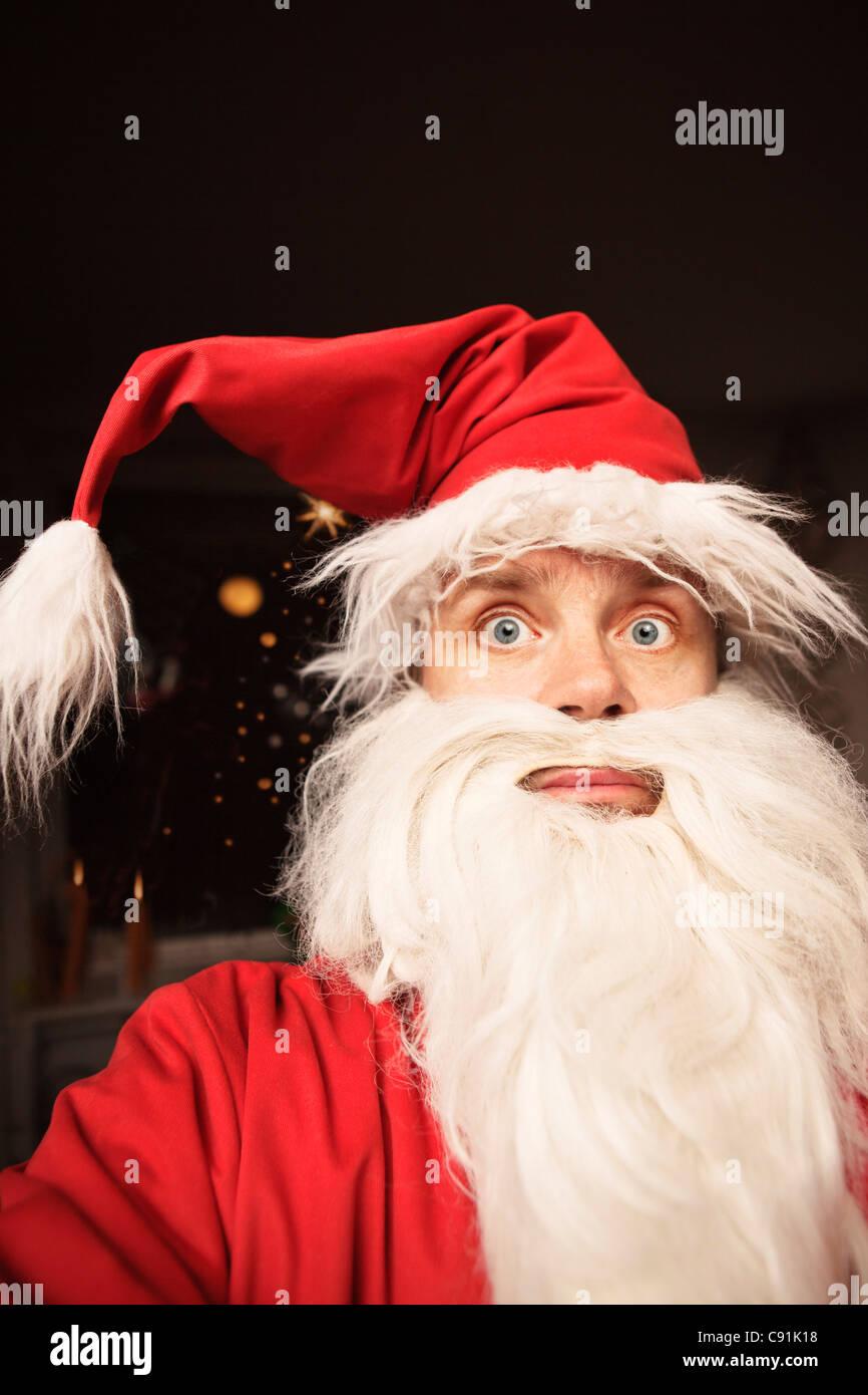 Man wearing Santa Claus suit - Stock Image