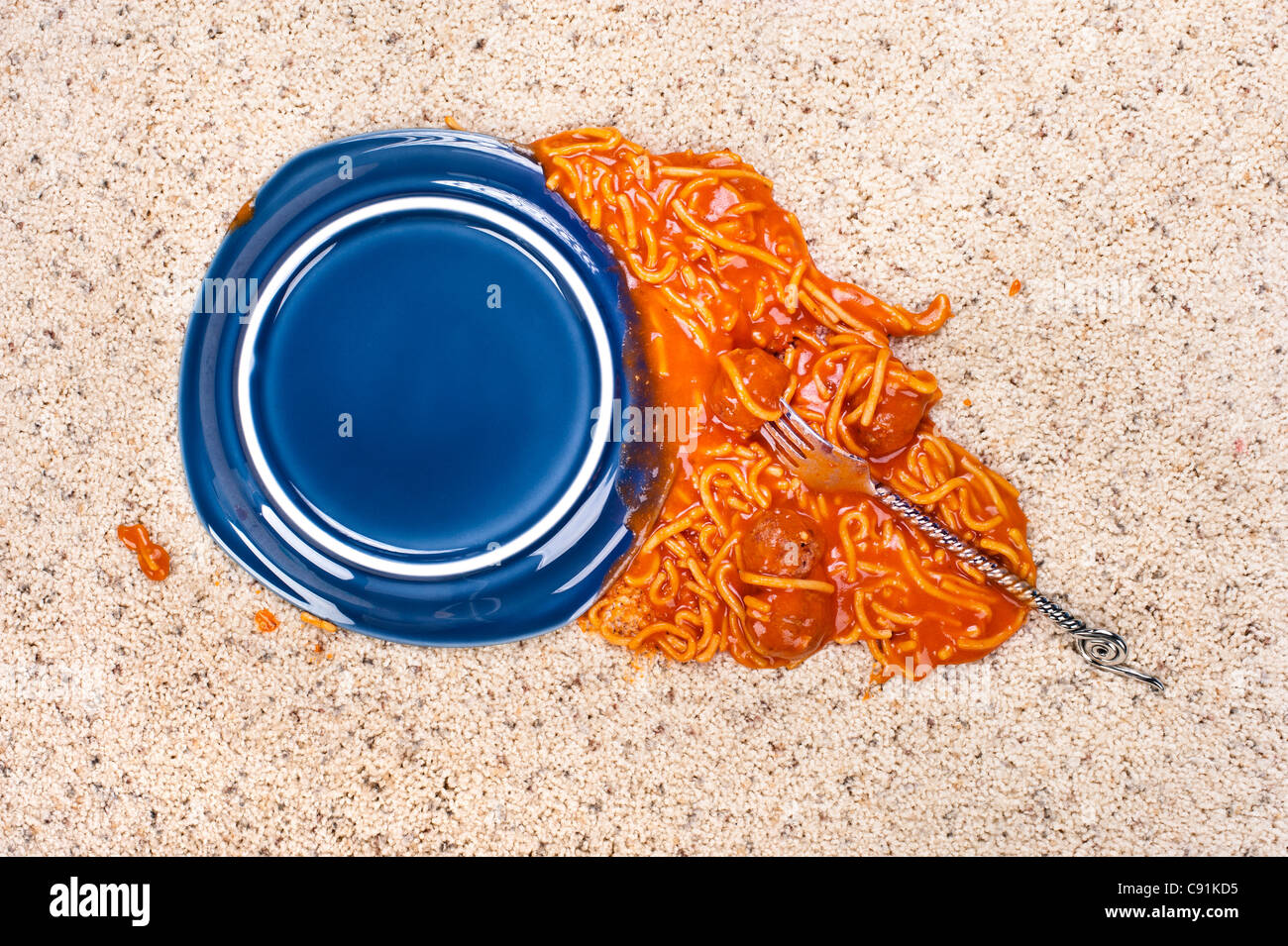 A dropped plate of spaghetti on new carpeting. - Stock Image