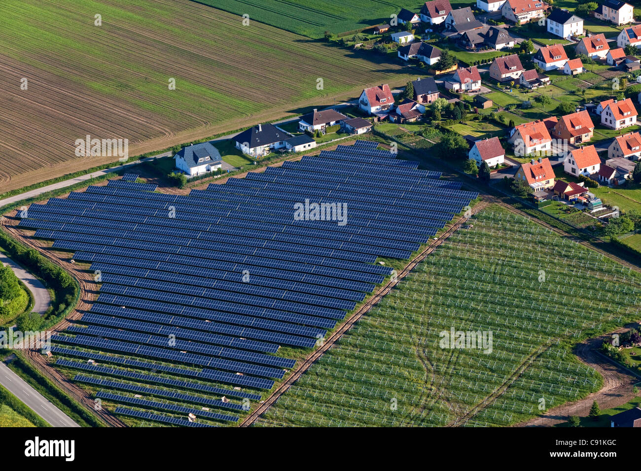 Aerial view of solar panels near Holzminden, housing settlement, Lower Saxony, Germany - Stock Image