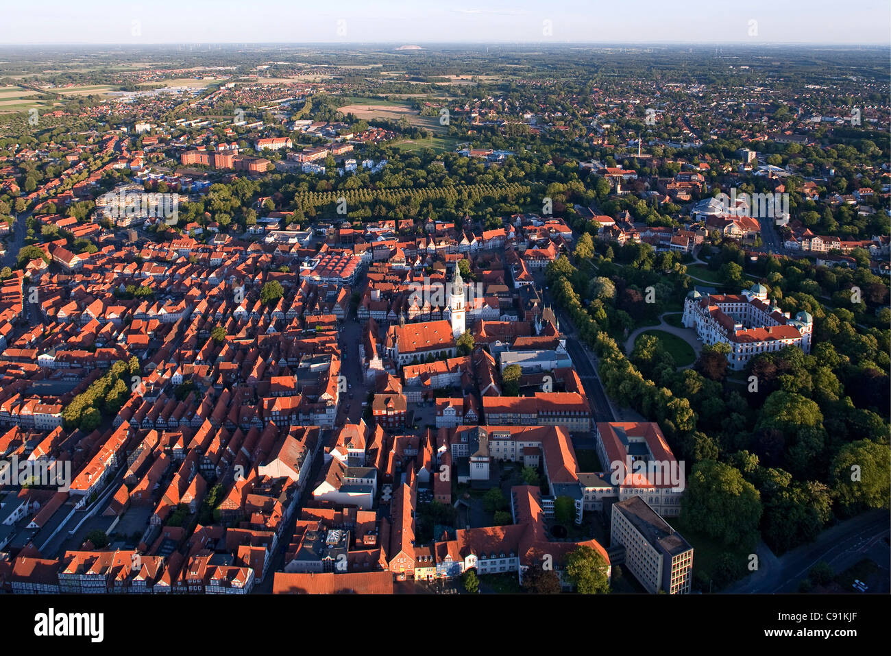 Aerial view of Celle castle and gardens red roofs of the old town church of St. Marien and avenue of trees in the - Stock Image
