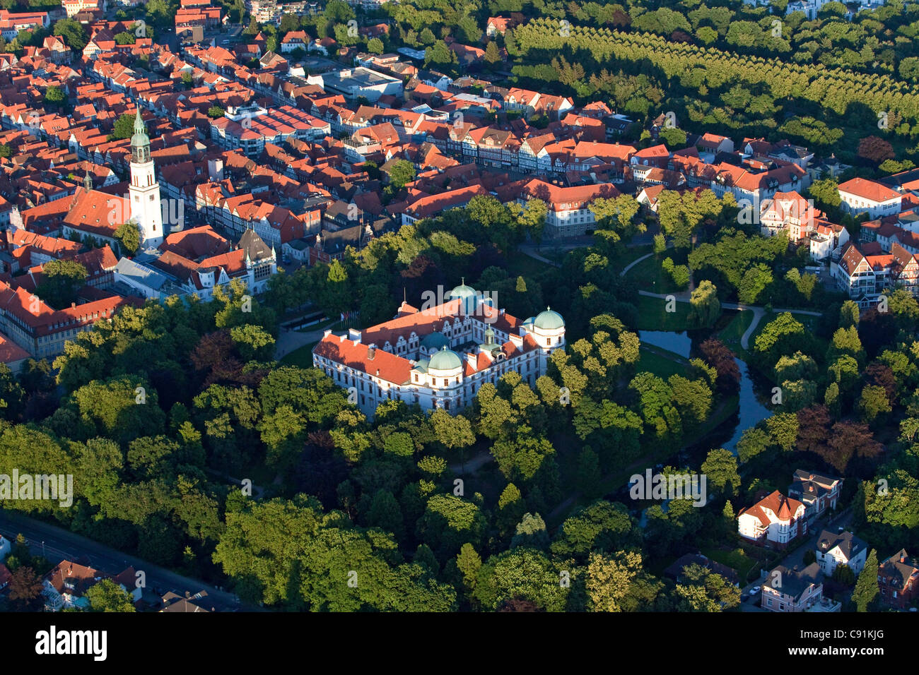 Aerial view of Celle castle and gardens red roofs of the old town church and Celle avenue of trees in the French - Stock Image