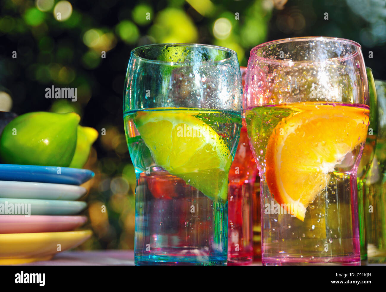 Fruity drinks in colorful glasses - Stock Image