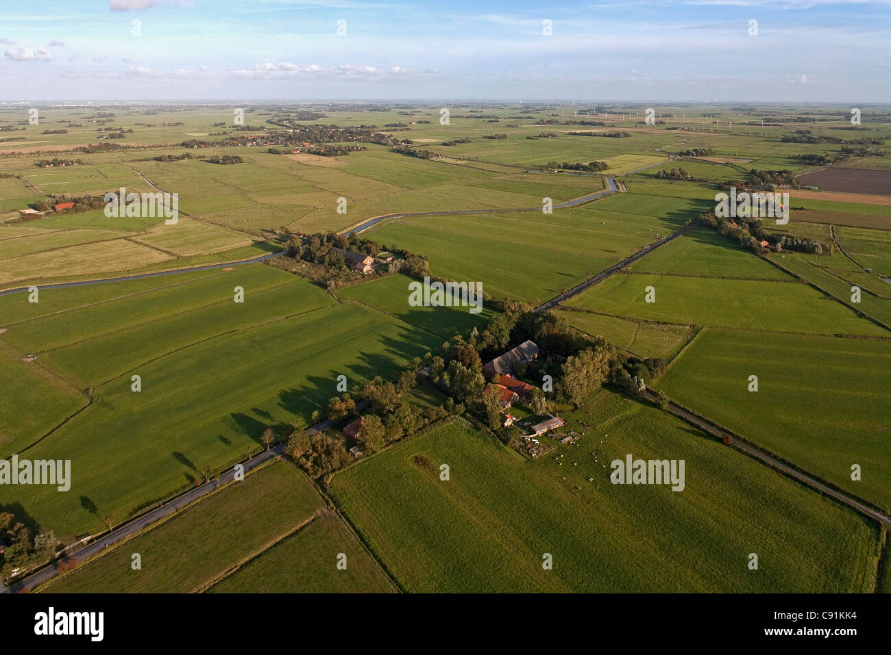aerial view of meadows, farms and farmland, near Cuxhaven, Lower Saxony, Germany - Stock Image