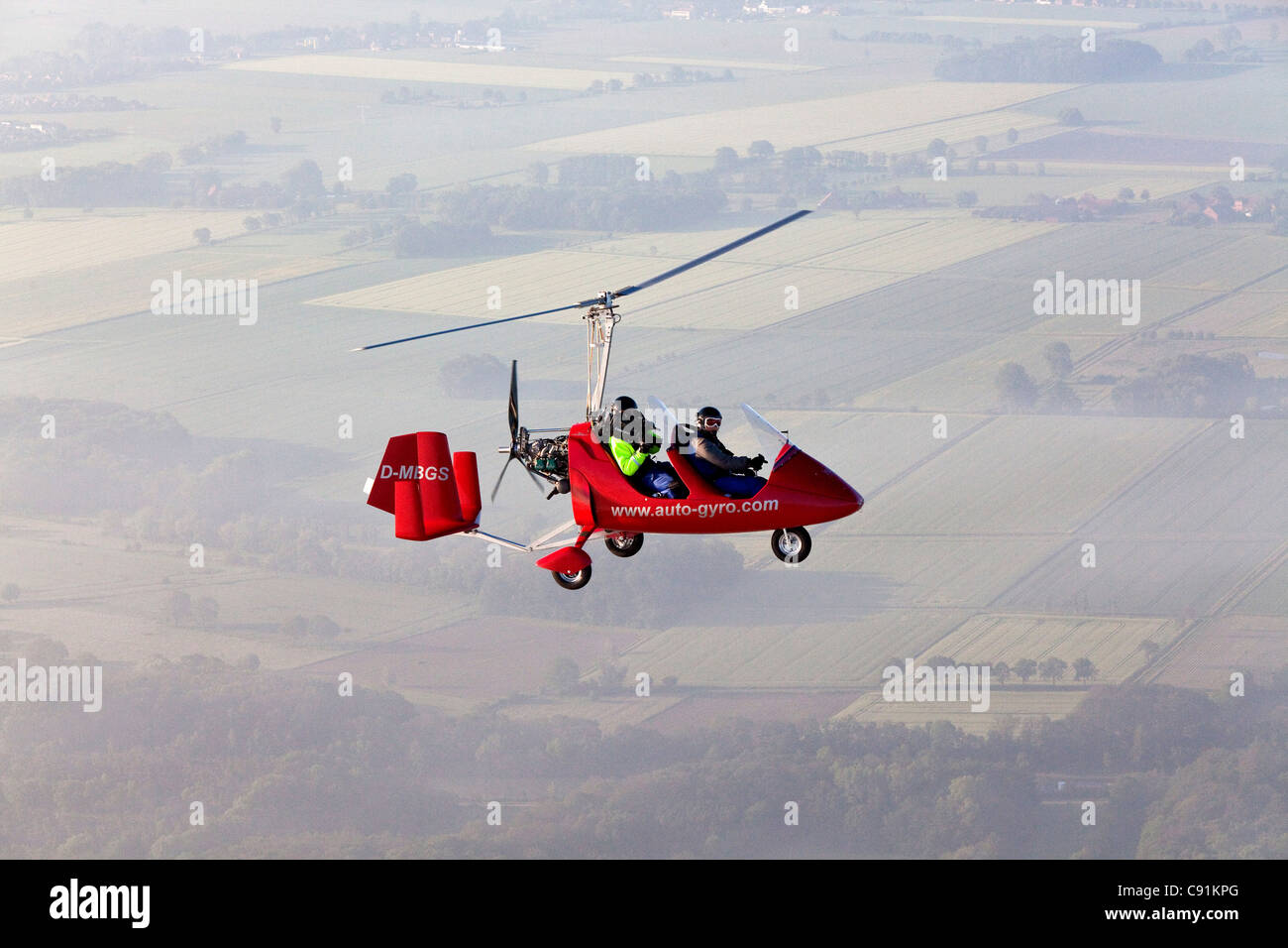 Aerial view of a two-seater autogyro, gyrocopter with cameraman, Lower Saxony, Germany - Stock Image