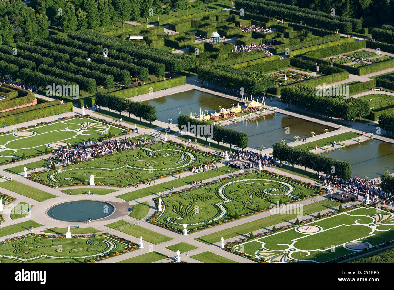 Aerial view of a small fete in the garden of Herrenhausen Gardens, Hannover, Lower Saxony, Germany - Stock Image