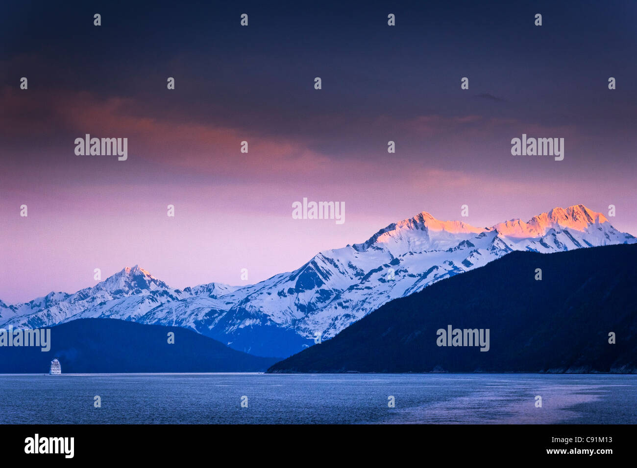 Holland America Cruise Ship New Amsterdam sailing through Lynn Canal at sunset, Inside Passage, near Haines, Southeast - Stock Image