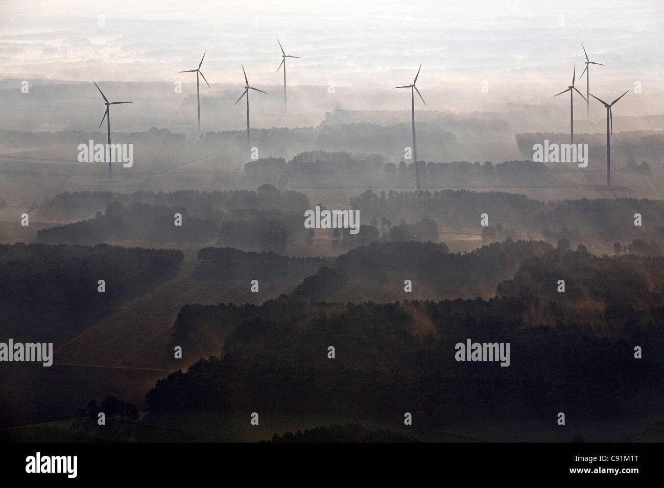 Aerial view of a wind farm in the early morning mist, Lower Saxony, Northern Germany - Stock Image