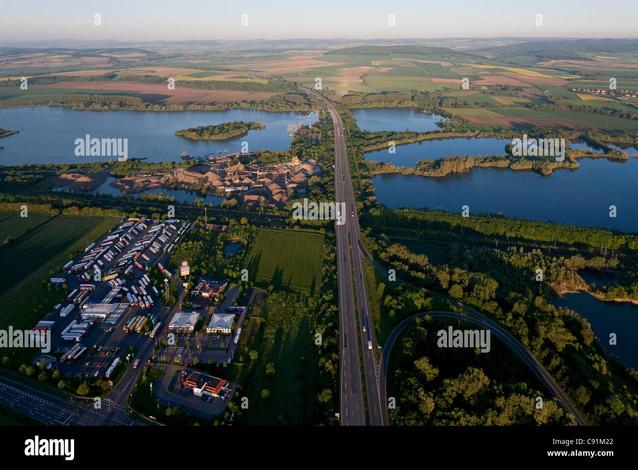 Aerial of Autobahn A7 crossing shingle ponds near Northeim, Lower Saxony, Germany - Stock Image