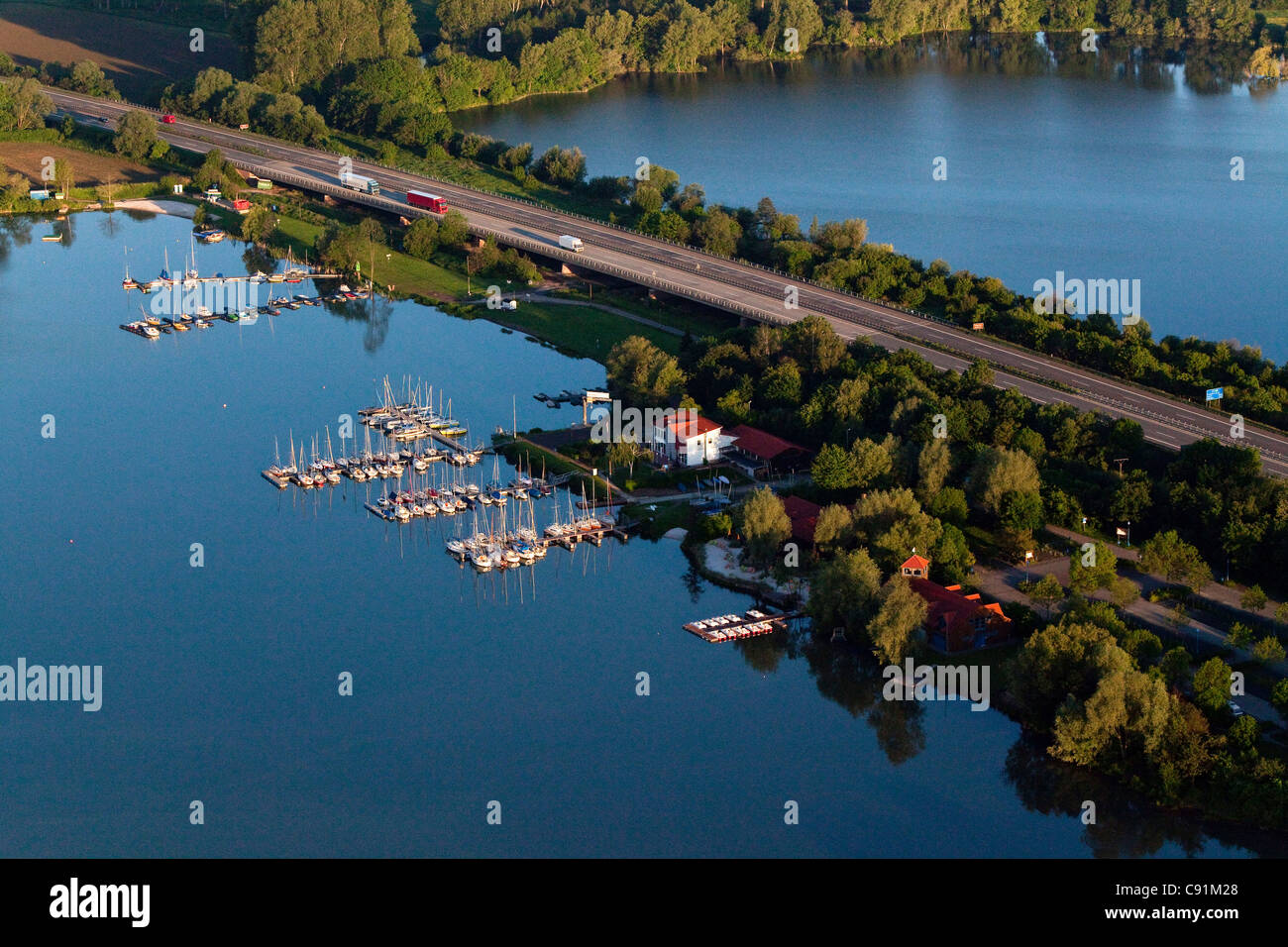 Aerial view of the Autobahn A7 and shingle ponds near Northeim, boats, Lower Saxony, Germany - Stock Image