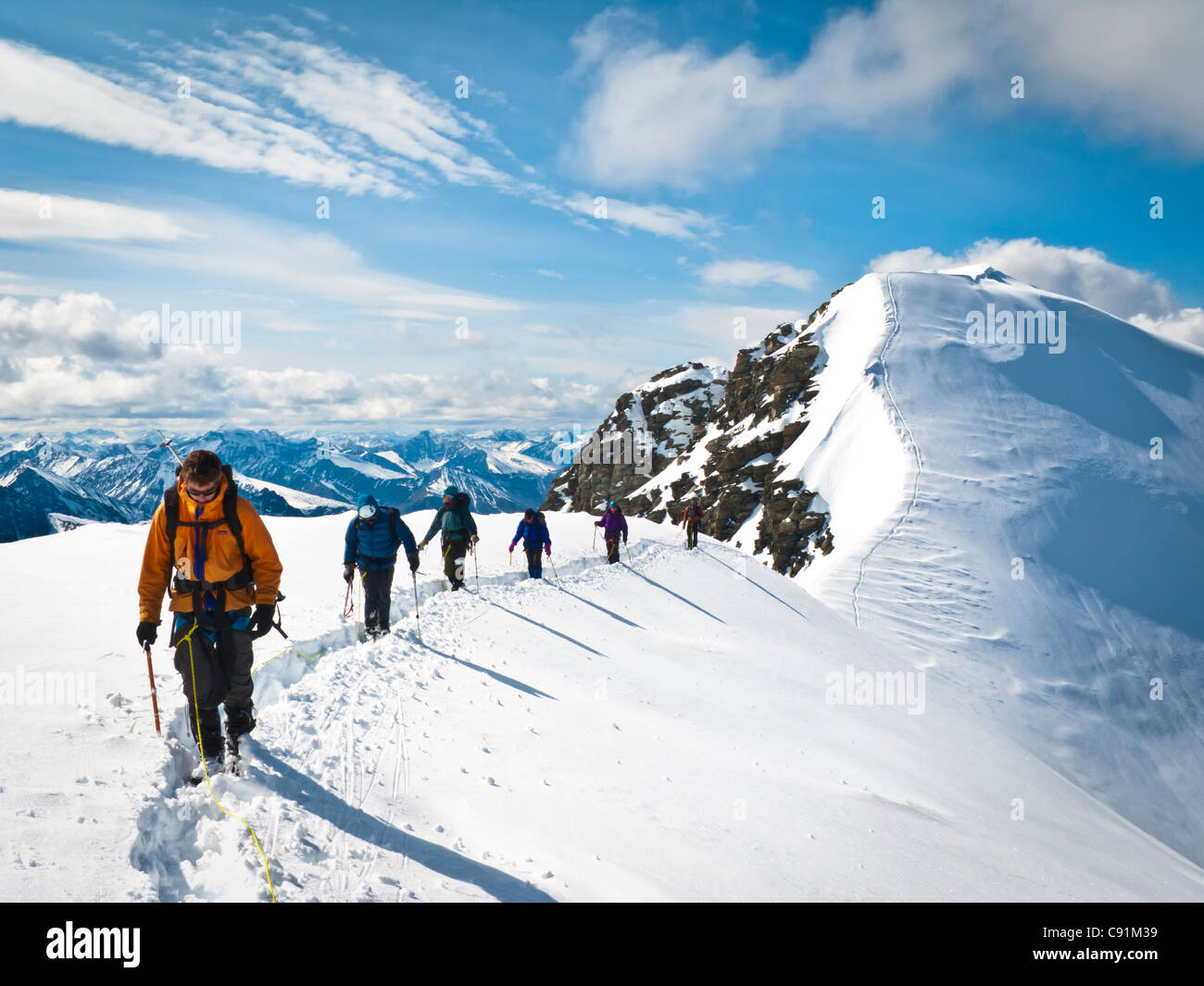 Roped mountaineering team descending the summit north ridge of Mount Chamberlin, ANWR, Brooks Range in Arctic Alaska - Stock Image