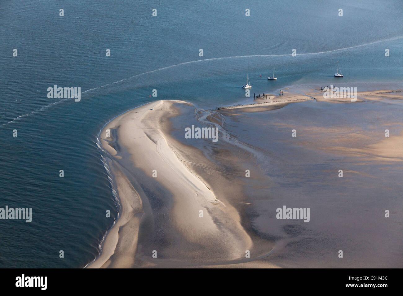 Aerial of yachts anchored on a sandbank, Wadden Sea, Lower Saxony, Germany - Stock Image
