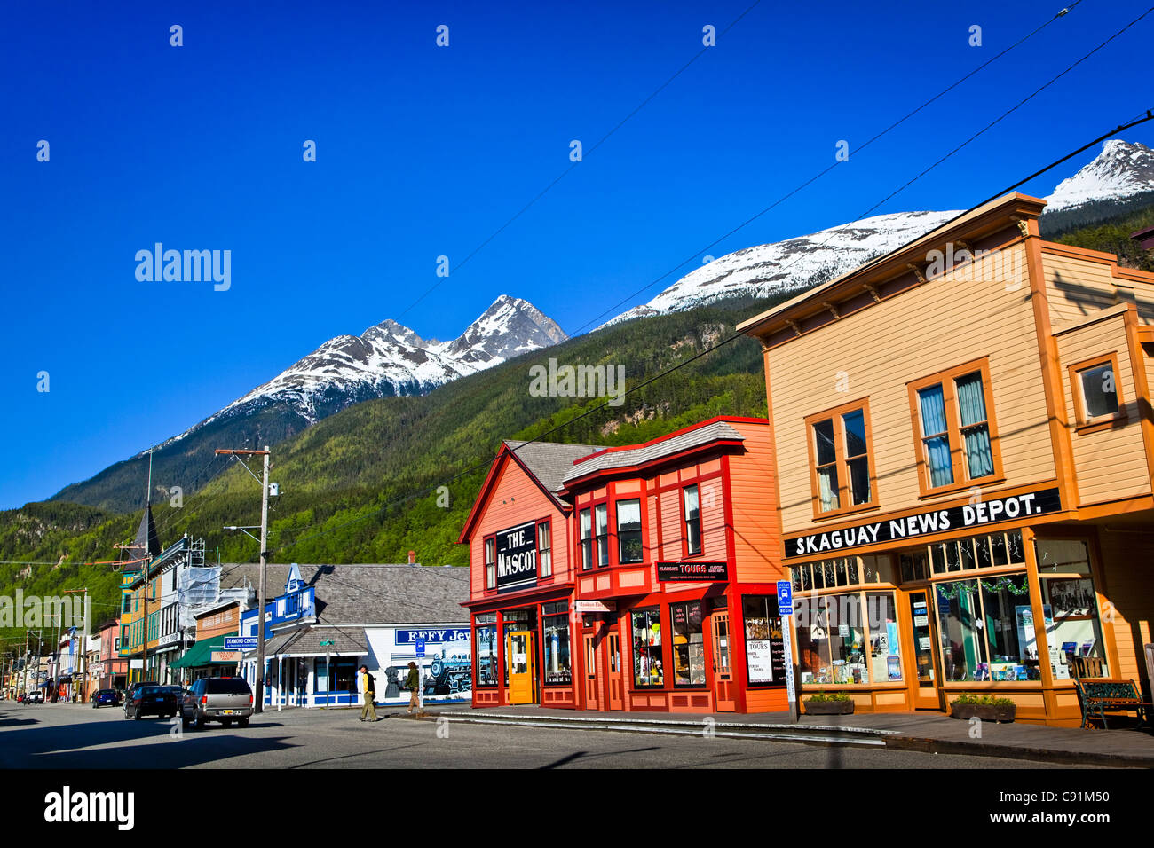 Buildings in historic downtown Skagway on a sunny day, Southeast Alaska, Summer - Stock Image