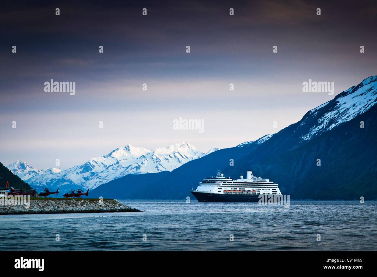 Holland America cruiseship Volendam leaving port of Skagway at twilight, Skagway, Southeast Alaska - Stock Image