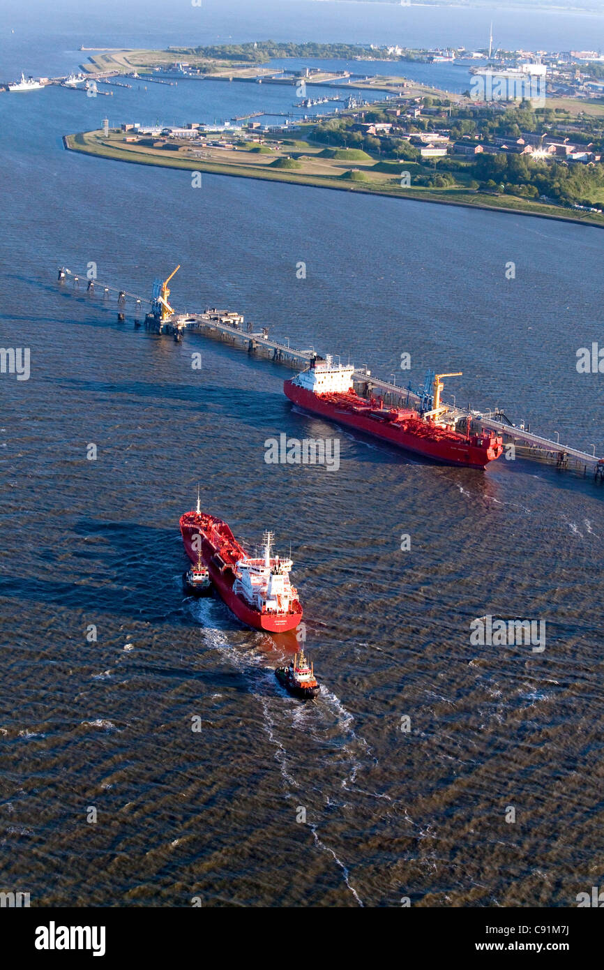 Aerial view of a red oil tanker, oil pier, Wilhelmshaven, Lower Saxony, Germany - Stock Image