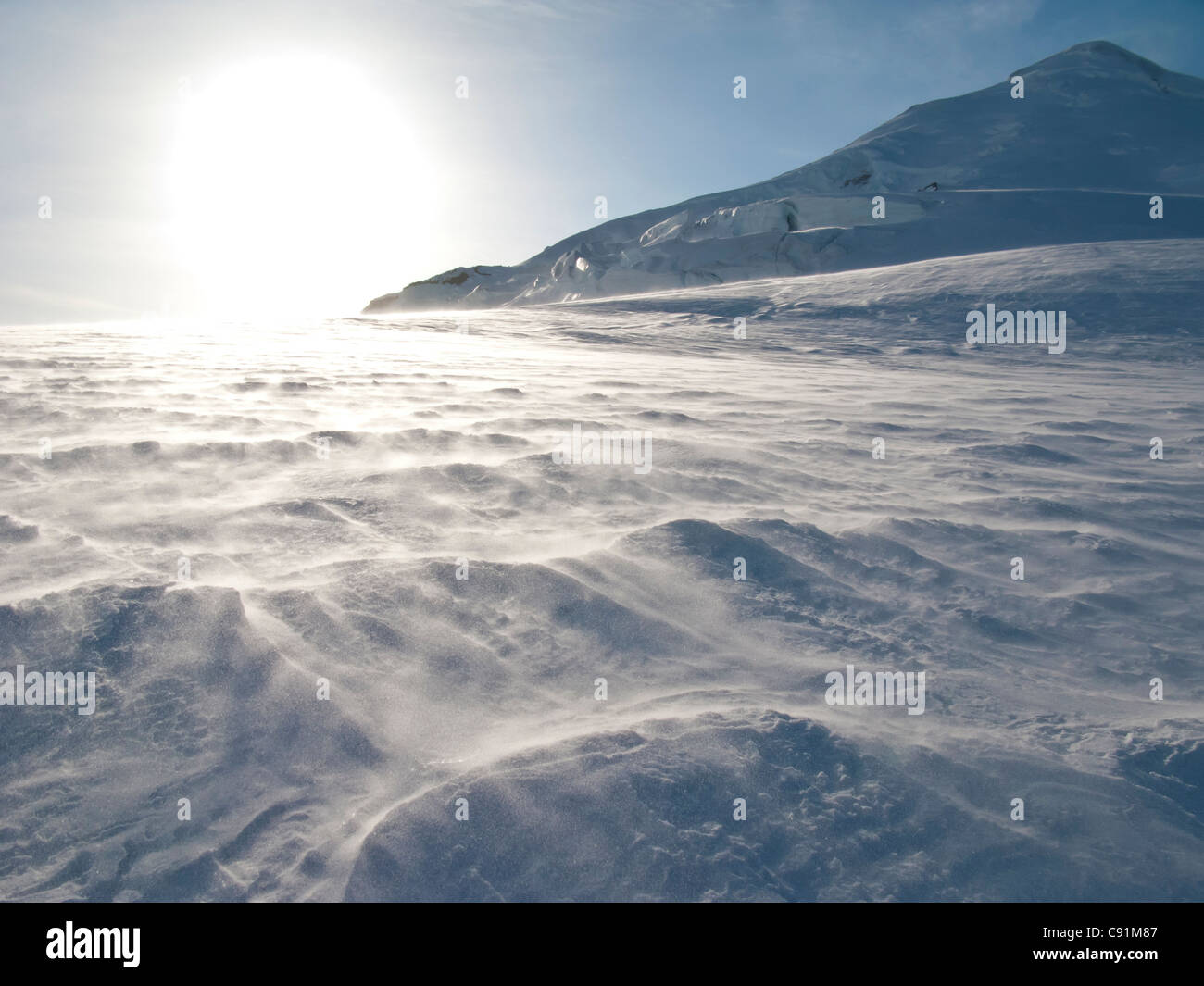 Blowing snow on northwest ridge of Mount Iliamna above the Tongue Glacier, Chigmit Mountains, Southcentral Alaska, - Stock Image