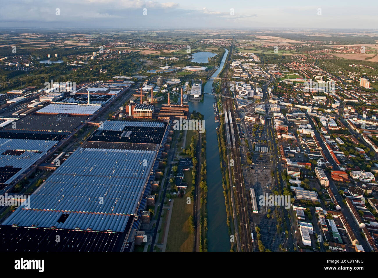Aerial view of the power plant and factory at VW Autostadt Wolfsburg, Mittelland Canal, Lower Saxony, Germany - Stock Image