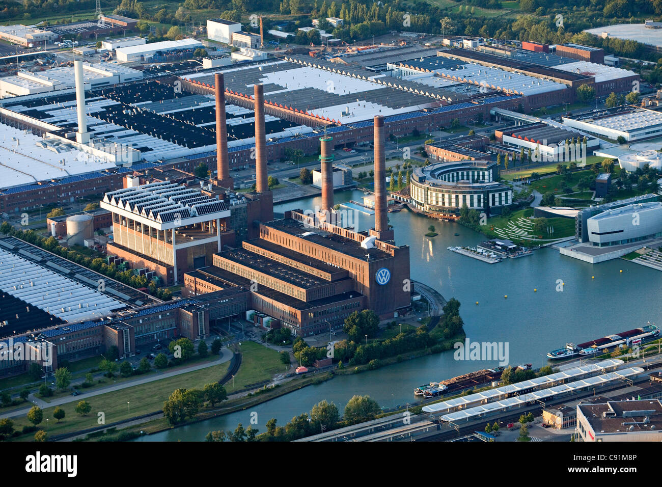Aerial view of a power plant and VW Autostadt Wolfsburg, Lower Saxony, Germany - Stock Image