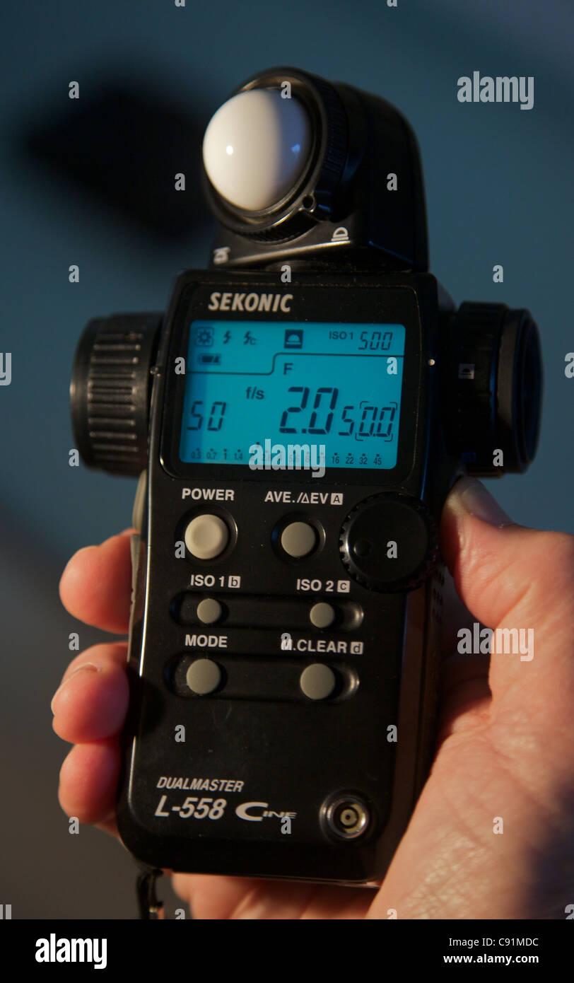 Taking a light meter reading - Stock Image