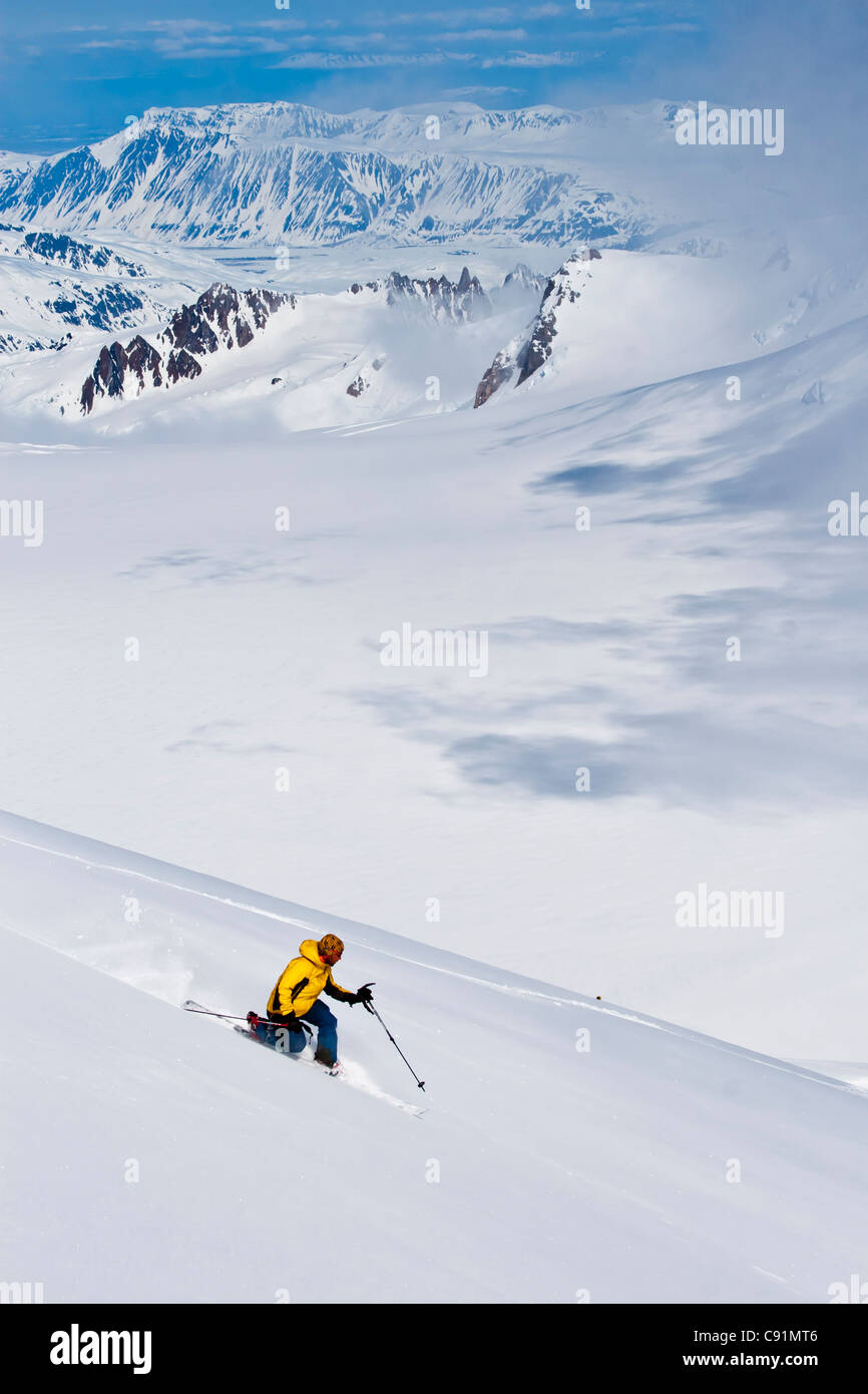 Skiers descending from the summit of Mount Gerdine in the Tordrillo Mountains, Winter in Southcentral Alaska - Stock Image