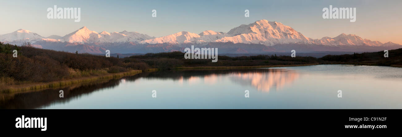 Sunset view of Mt. McKinley and Mt. Brooks reflecting in a pond along the park road in Denali National Park & - Stock Image
