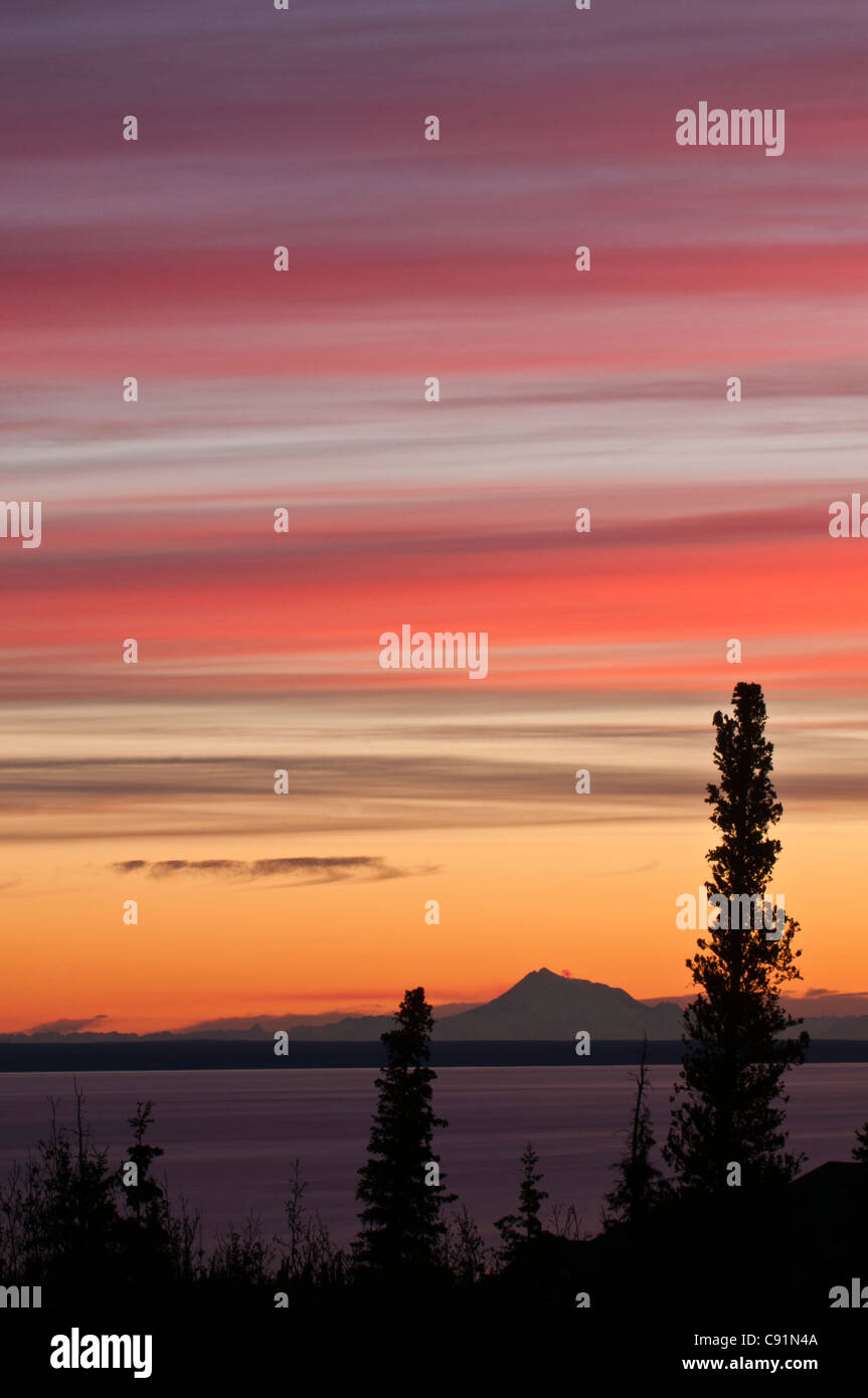 Sunset view of Mt. Redoubt as seen across Cook Inlet, near Anchorage, Southcentral Alaska, Autumn - Stock Image