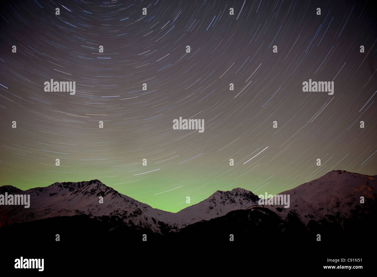 time elapse view of the night sky and star trails over the Chugach Mountains, Portage Valley, Southcentral Alaska, - Stock Image