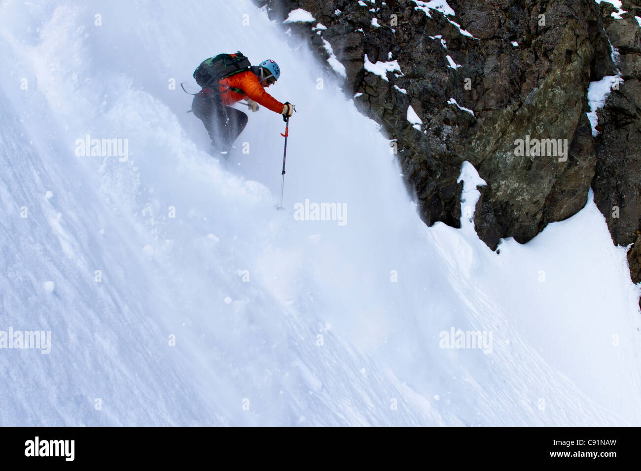 Man backcountry skiing on the north face of Korohusk Peak in the Ram Valley, Chugach Mountains, Eagle River, Southcentral - Stock Image