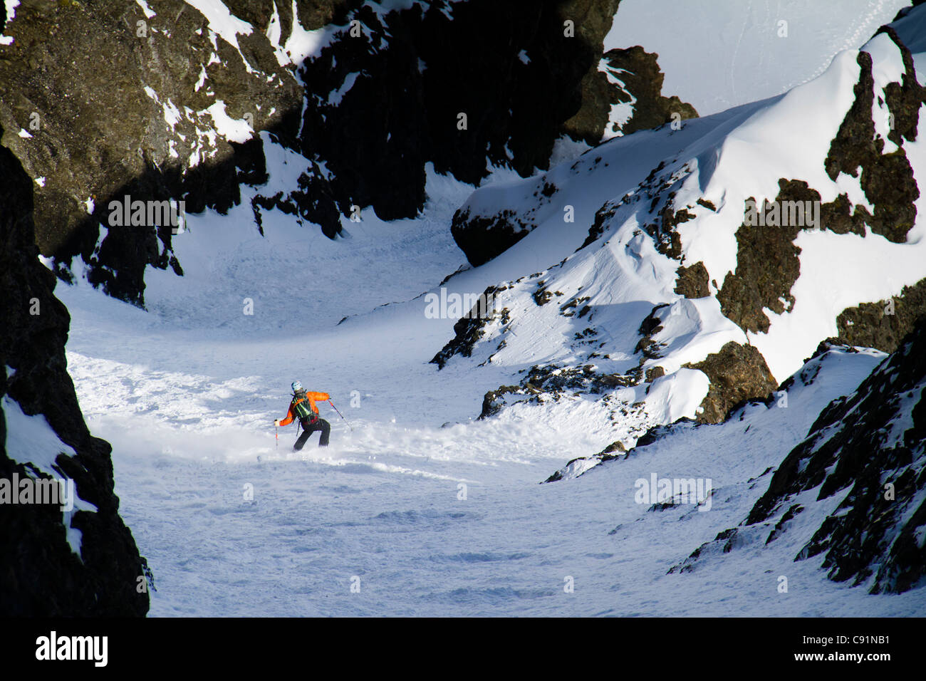 Man backcountry ski mountaineering on the north face of Korohusk Peak in the Ram Valley, Chugach Mountains, Eagle - Stock Image