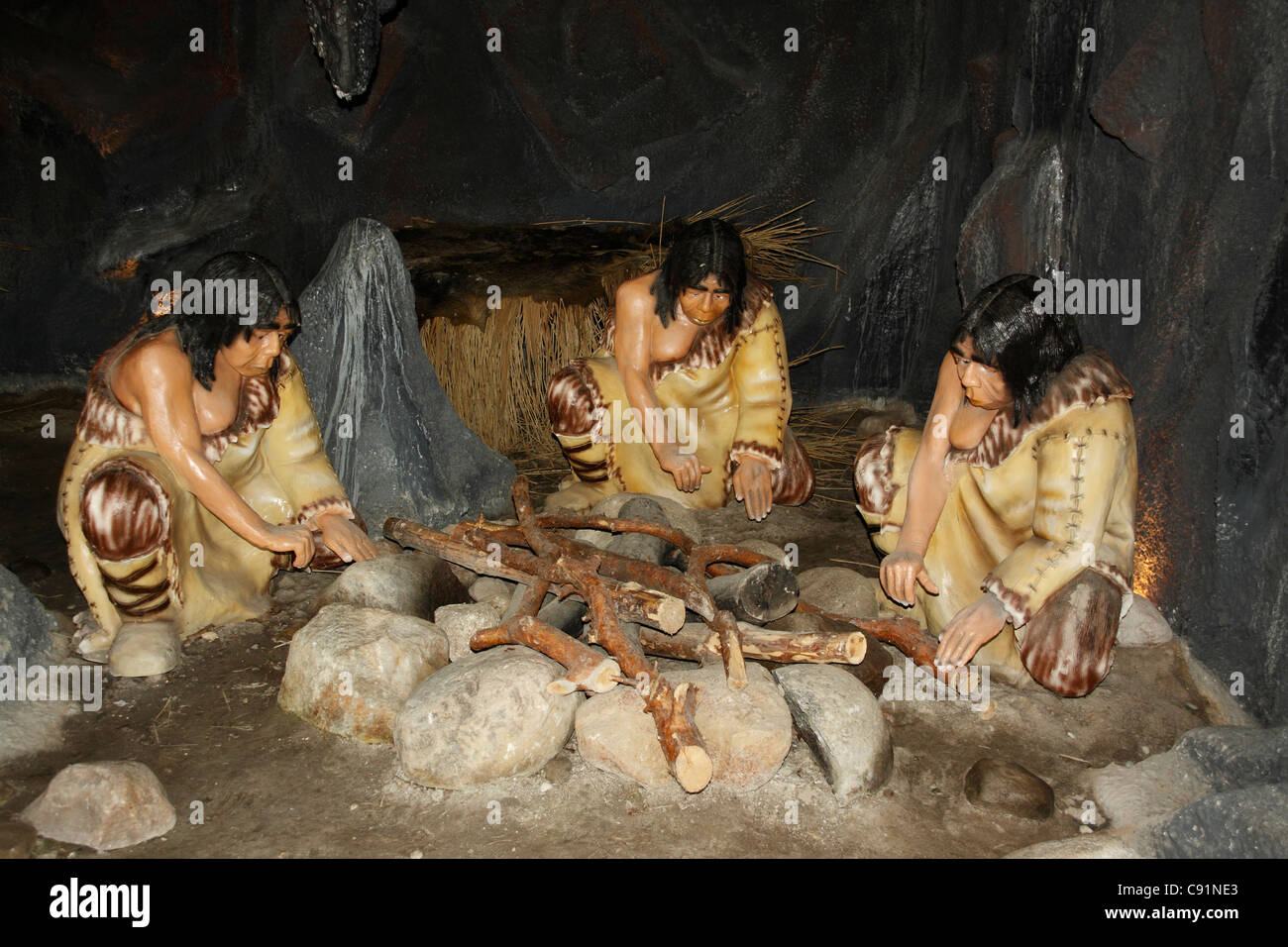 Neanderthal people sitting at the fire in a cave, Leba ...