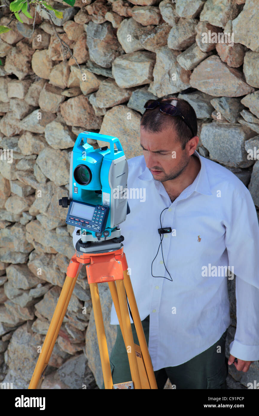 a surveyor at work - Stock Image
