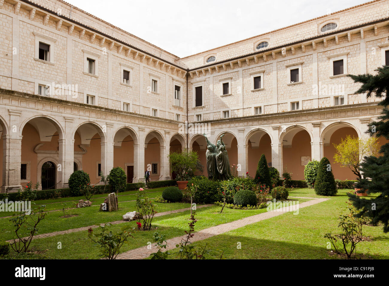 The entrance cloister of Monte cassino Abbey and the death of Saint Benedict Statue - Stock Image