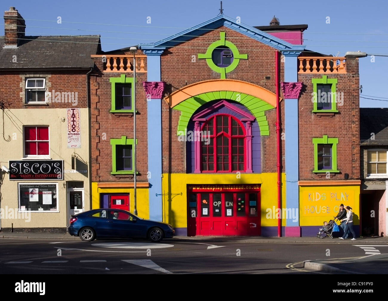 brightly painted former cinema THE SAVOY in Halstead Essex now used as a playgroup and kids party centre - Stock Image
