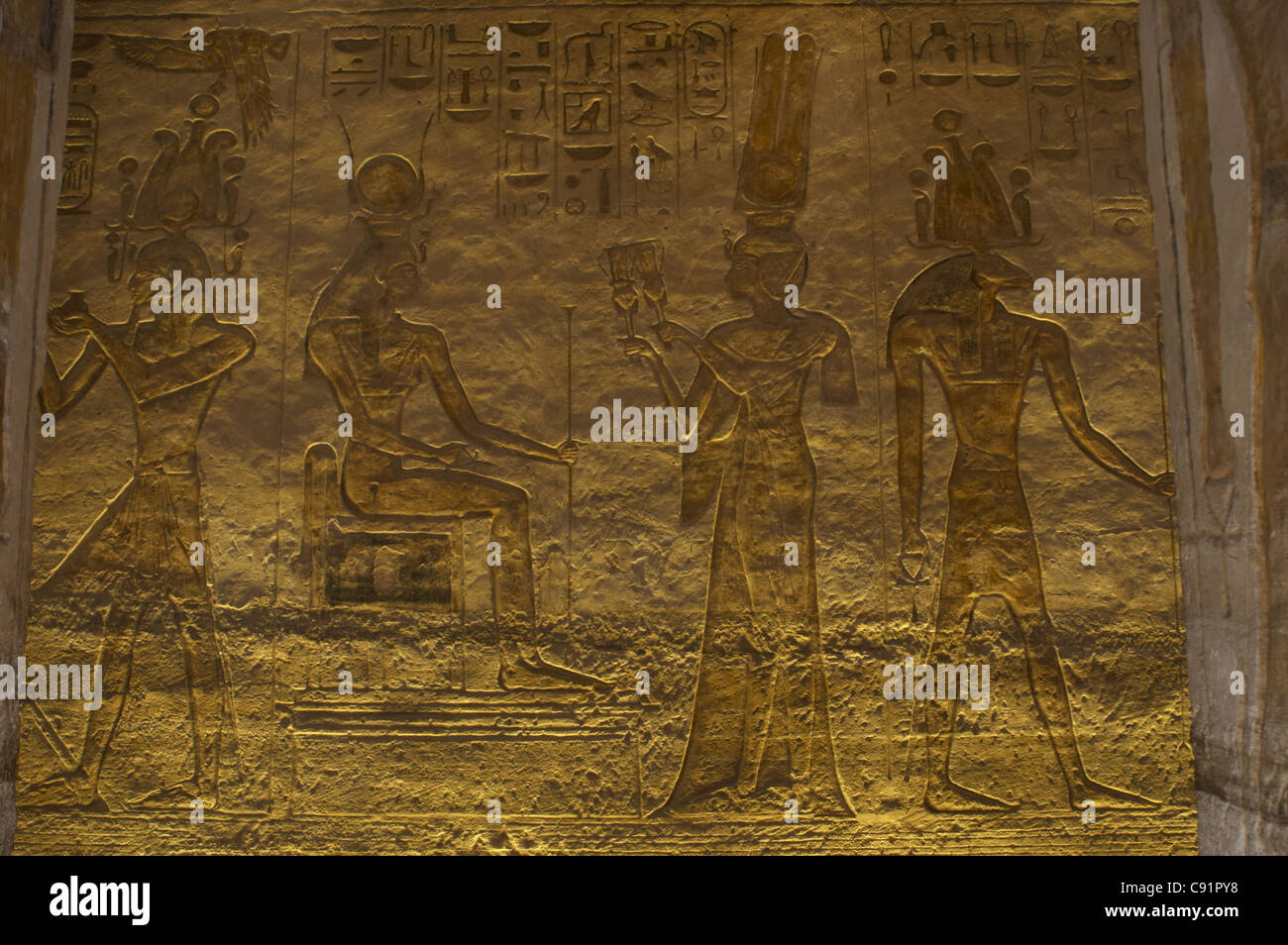 Egyptian art. Small Temple or Temple of Hathor. Relief depicting the pharaoh Ramses II surrounded by gods. Abu Simbel. - Stock Image
