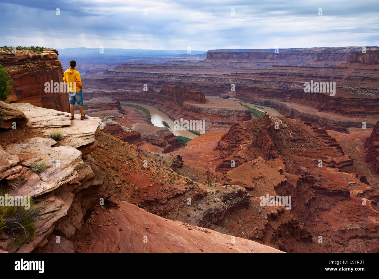 Tourist at Dead Horse Point watching the Colorado River, Dead Horse Point State Park Stock Photo