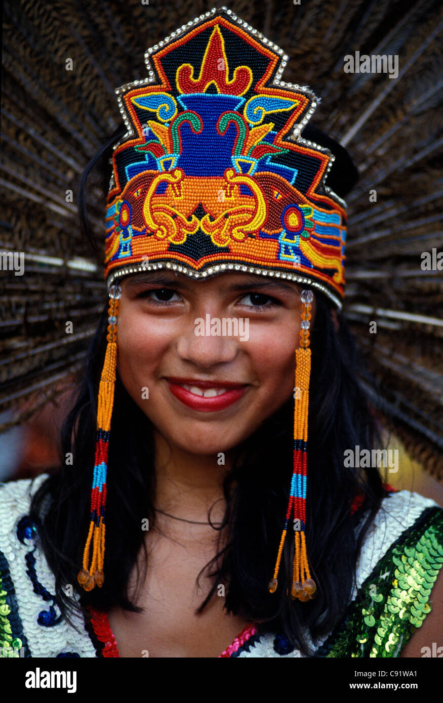 Young Mexican girl in Aztec costume during Cinco de Mayo festivities in downtown Los Angeles California - Stock Image