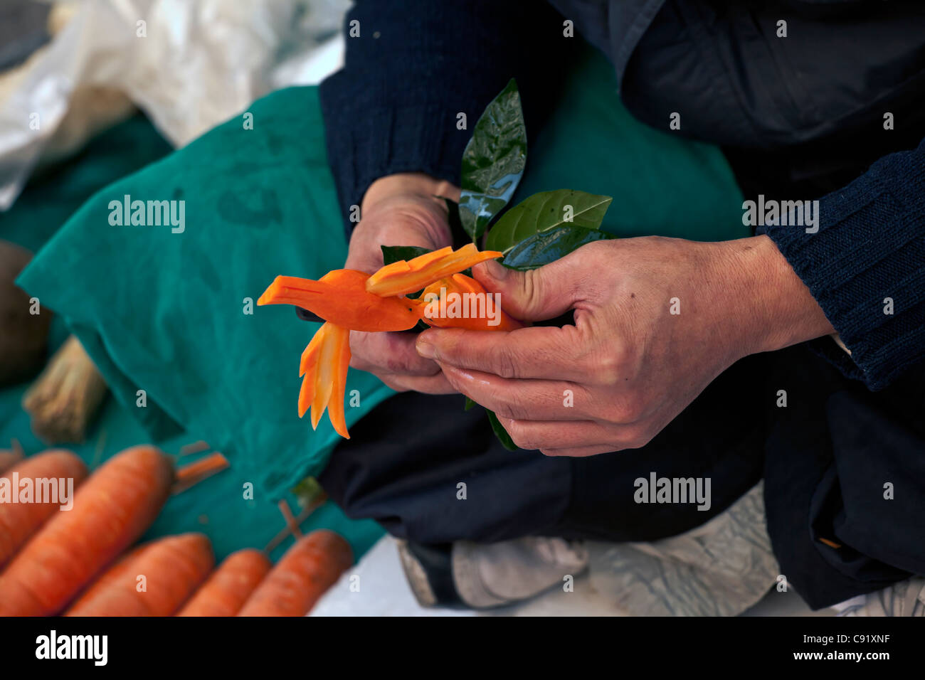 Food sculptor in the Milanese pedestrian, Lombardia, Italy - Stock Image